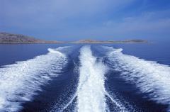 adriatic sea near rovinj istria croatia motorboat rear wave - stock photo