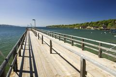 Stock Photo of landing stage for boats with view to the starnberger sea