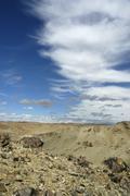 Stock Photo of bizarre cloud formation above barren landscape near ongyin monastery mongolia