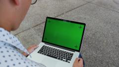 Close Up Of Man Typing on Laptop Computer With Green Screen - stock footage
