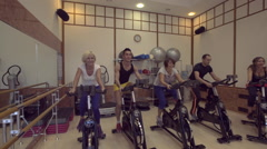 Group training in the gym on a stationary bike Stock Footage