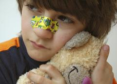 Stock Photo of boy with band|aid on nose