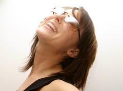 laughing, young woman with sunglasses - stock photo