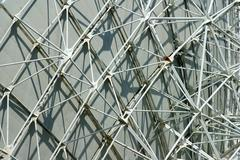 support structures on the rear side of a parabolic antenna satellite land ear - stock photo