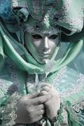 portrait of turquoise green mask at carneval in venice, italy - stock photo