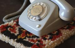 Attendance in the parents house: detail and memories. old telephone with dial Stock Photos