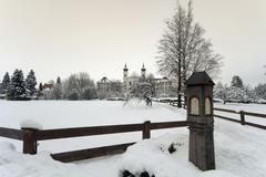 shrine in front of the monastery schlehdorf in winter, kochelsee, bavaria, ge - stock photo