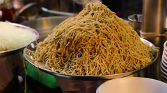 Liuhe Night Market - close-up mountain of fresh noodle Stock Footage