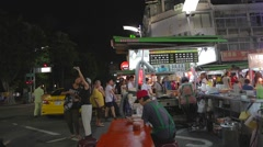 Liuhe Night Market pan - people at night market Stock Footage