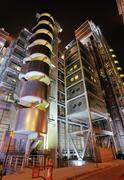 Building of the insurance agency lloyds of london, colourfully illiminated at Stock Photos