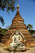 sitting buddha figure in ruined aung zaw paya ava inwa mandalay burma - stock photo
