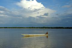 Solitary boat on the mekong river near stung treng cambodia Stock Photos
