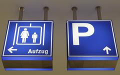 Signs for parking and elevators in a departement store Stock Photos