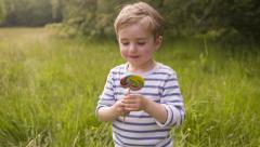 Boy Eating Colorful Lollipop Stock Footage