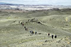 Stock Photo of hiking group in barren landscape near ongiyn monastery mongolia