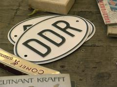 Old gdr license number on the flea market, nationality identification symbol. Stock Photos