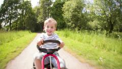 Little Boy in Pedal Car Stock Footage