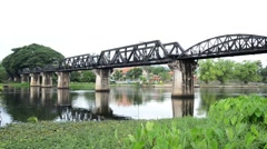 Railway Bridge over the River Kwai. Kanchanaburi, Thailand Stock Footage
