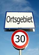 30km/h speed restriction in town - stock photo