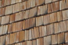 wooden shingles on weatherboard clapboard house in the town of spitzingsee up - stock photo