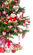colorfully decorated isolated christmas tree with red decoration - stock photo
