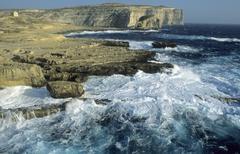 rocky coast at dwejra bay, gozo island, malta - stock photo