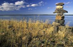 cairn or stone man or inukshuk on the mackenzie river, northwest territories, - stock photo