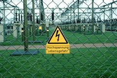 Dangersign high voltage, mortal danger, in front of a voltage transformation  Stock Photos