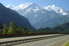 no traffic on the highway in front of mount mont blanc autoroute blanche e25  - stock photo