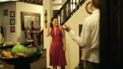 young, pretty woman showing his boyfriend a new dress before party at home HD - stock footage