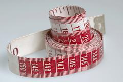 Stock Photo of measuring tape, metric tape measure for needlework, sewing work etc..