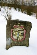Stock Photo of historical boundary stone with colored heraldic figure