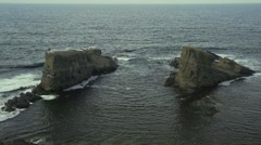 Two high cliffs with birds perched surrounded by sea-Black sea slow motion Stock Footage