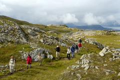 mr hiking group on the path through the high fjell vestvagoya lofoten norway - stock photo