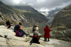 Stock Photo of women are resting and enjoying the sight of glacier de tre la tete haute-savo