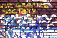 Graffiti on a brick wall Stock Photos