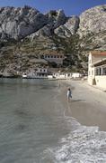 Girl at the beach of calanque de sormiou, provence, france Stock Photos