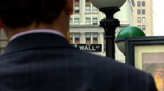 Wall Street Sign & Businessman HD Stock Footage
