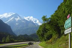 access road to the highway in front of mount mont blanc autoroute blanche e25 - stock photo