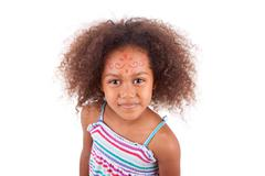 cute young african american  girl white painting on the face - black people - stock photo