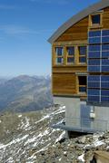 Stock Photo of modern mountain hut refuge de tete rousse at the ascent of mt. blanc haute-sa