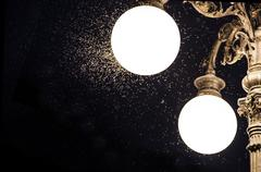 close-up of an old street lamp with mosquitoes - stock photo
