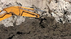 CLOSE UP. Bulldozer digging on the ground. Stock Footage