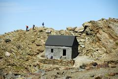 emergency hut baraque forestiere des rognes at the ascent of mt. blanc haute- - stock photo