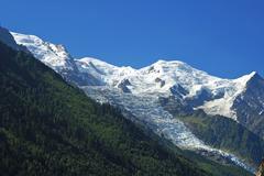 view at mont blanc dome du gouter aiguille du gouter glacier des bossons cham - stock photo