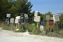 different kinds of letterboxes mailboxes standing at the wayside, costa blanc - stock photo