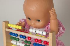 learning arithmetics, doll using an abacus - stock photo