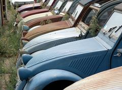 scrap iron place with various generations of the citroen 2cv (deuxchevaux - d - stock photo