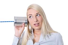 Communication or advertising concept: young isolated woman calling with tin c Stock Photos