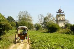 horse cart at angled tower nanmyin watchtower ava inwa mandalay burma - stock photo